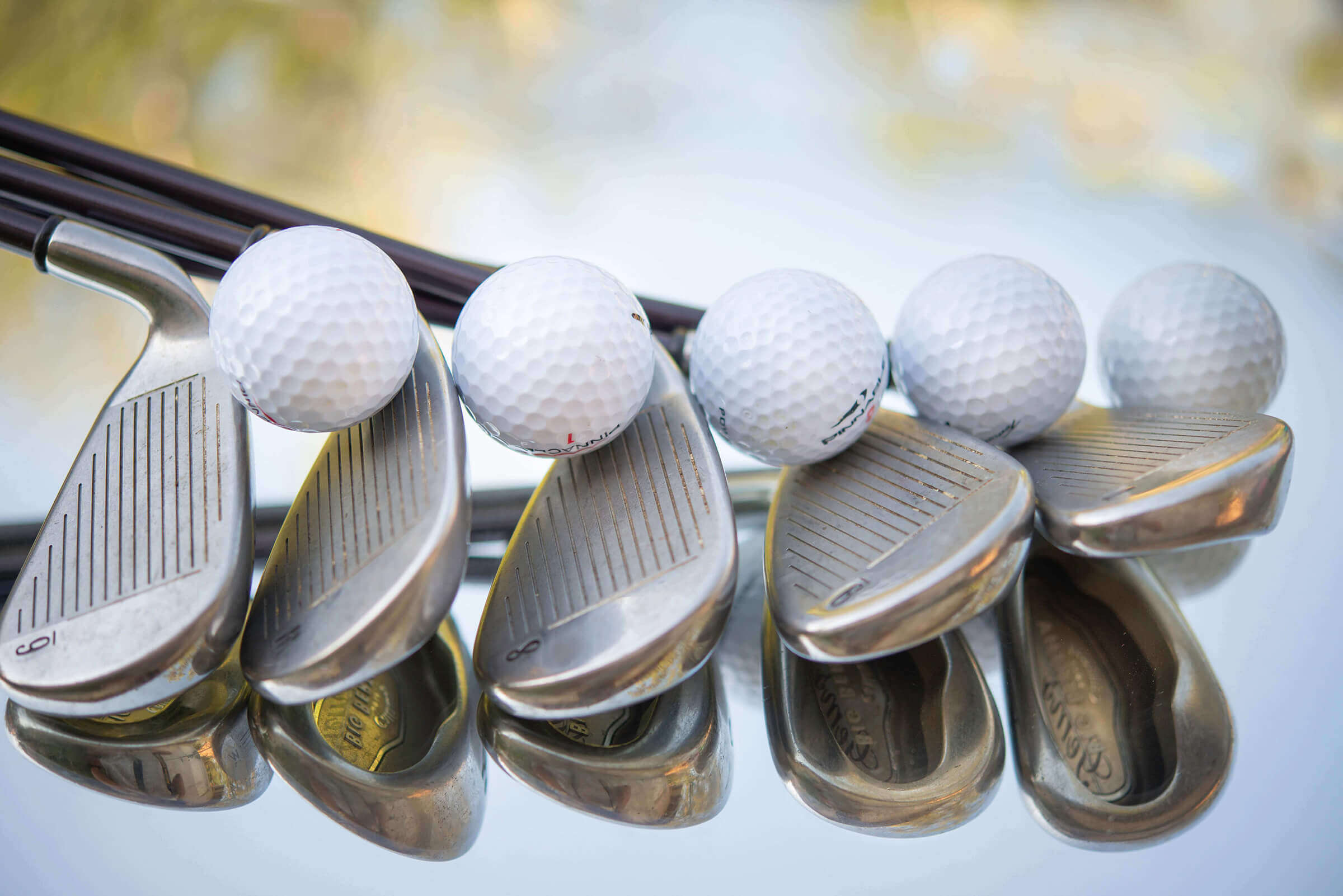 Golf clubs and Golf Balls on Mirror